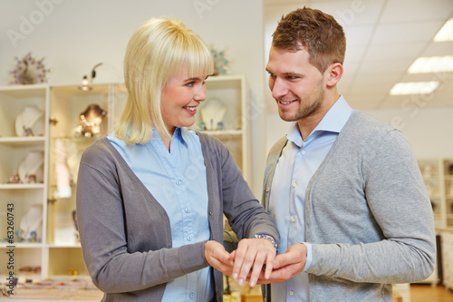 Salesman advising woman in jewelry store