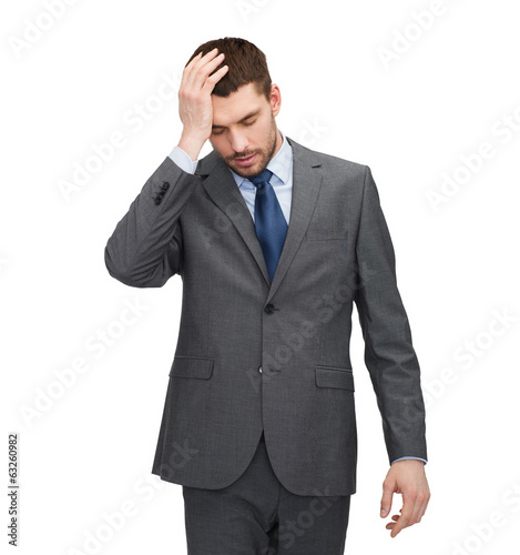 handsome businessman having headache