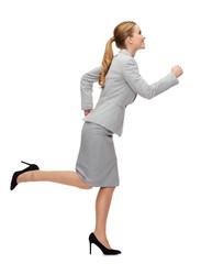 smiling businesswoman running