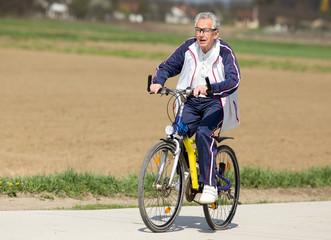 Senior man riding a bike