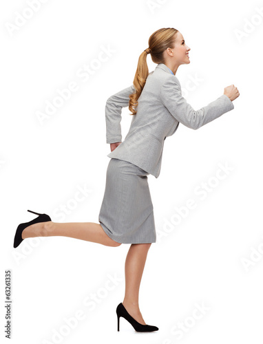 smiling businesswoman running