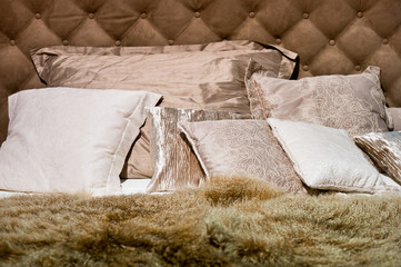 Brown pillows with furry duvet on the bed