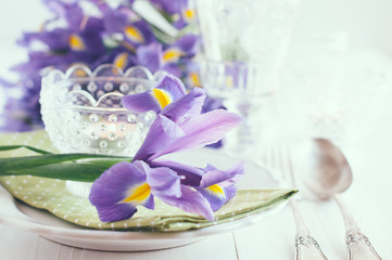 table setting with purple iris flowers