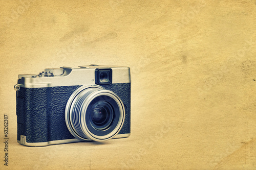 Vintage camera on a textured background