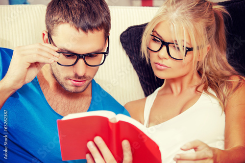 couple at home with book
