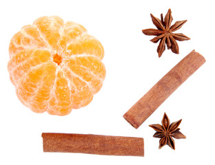 Ripe sweet tangerine and spices, isolated on white
