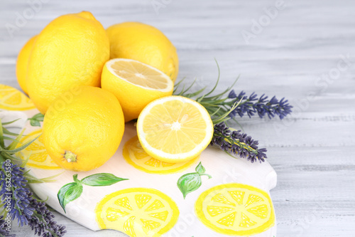 Still life with fresh lemons and lavender on wooden table