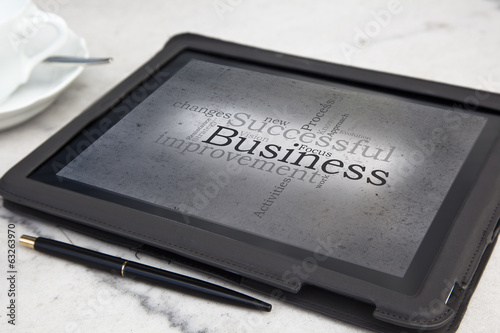 tablet with successful business word cloud