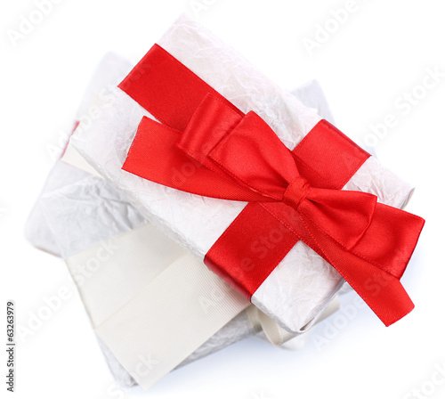 Beautiful gifts with ribbons, isolated on white