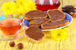 Bread with sweet chocolate hazelnut spread on plate on table
