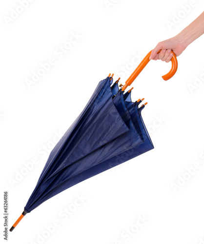 Blue Umbrella in hand isolated on white