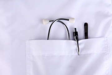 Doctor pocket with pen, stethoscope and other equipment,