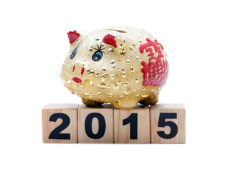 New Year 2015:  piggy bank and building blocks