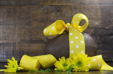 Happy Easter country style chocolate egg with yellow ribbon