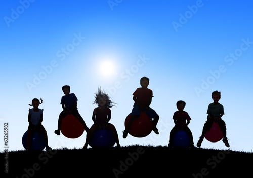 Silhouettes of Children Playing with Balls