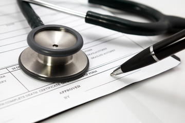 stethoscope and pen on blank Patient information