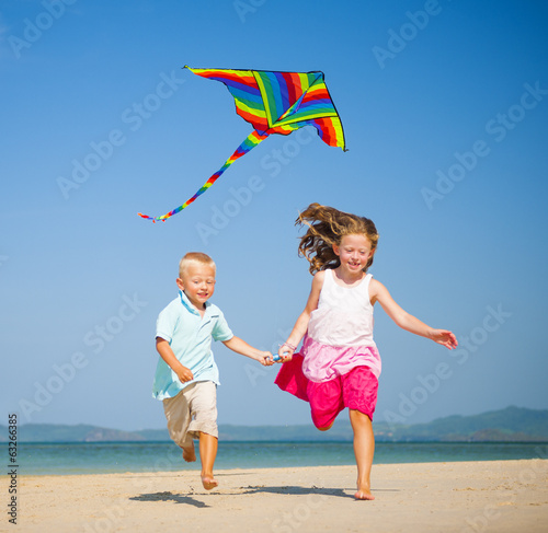 Children running on the beach