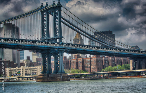 Side view of Manhattan Bridge structure and New York buildings