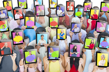 Multi-ethnic Group of People Holding Tablets
