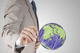 businessman hand drawing abstract globe as concept