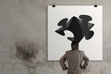 businessman looking at  Partnership Puzzle on poster as concept