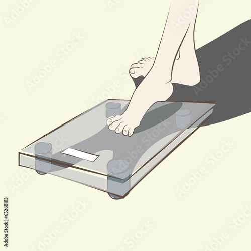 man stepping carefully on the scales