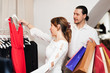 Couple choosing  dress at boutique