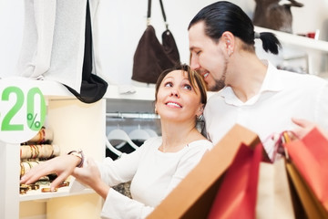 Young couple choosing bracelet at store