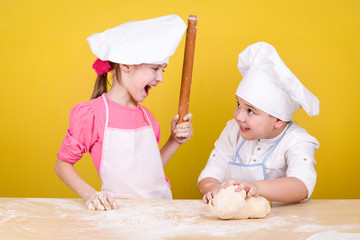Cheerful children cook pizza