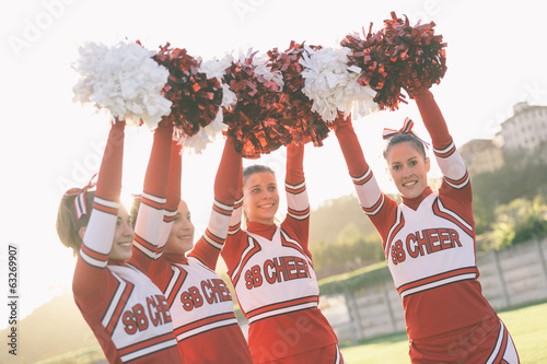 Group of Cheerleaders with Raised Pompom