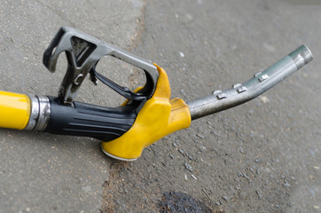 Yellow gas nozzle on ground