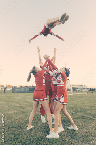 Group of Cheerleaders Performing Stunts