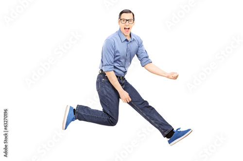 Young man doing an air guitar jump
