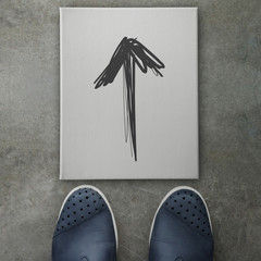 Hand drawn arrow design doodle on front of business man feet as