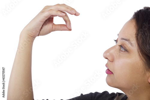 female hand picking up something invisible for composites