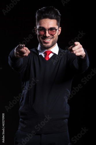 business man points at you with both hands