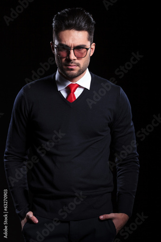 angry business man with hands in pockets
