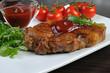 Pork steak with ketchup
