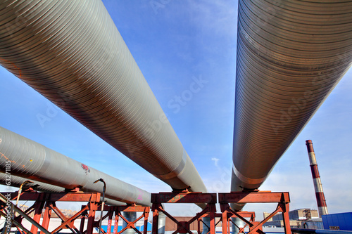 above-ground pipeline, lower shot against blue sky