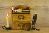 Wooden box with written implements poster