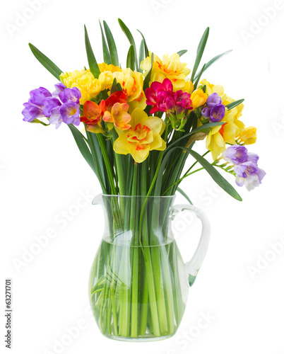 freesia and daffodil flowers in vase