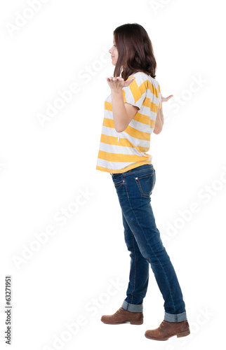 Back view of Beautiful business woman in yellow t-shirt looking
