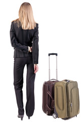 back view of thoughtful business woman traveling with suitcas.