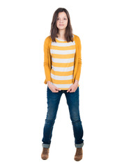 young woman standing in jeans and a T-shirt