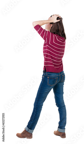 Back view of shocked woman in blue jeans.