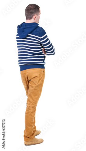 Back view of handsome man in striped hooded sweater.