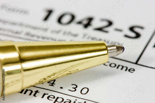 Golden pen on the  tax form