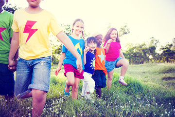 Multiethnic Children Walking Together in the Field