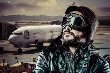 Captain, Pride pilot with black leather jacket and old glasses