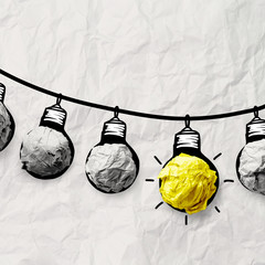hand drawn light bulb on wire doodle with crumpled paper as lead